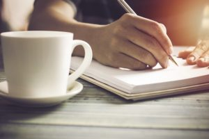 writers with paper and coffee cup