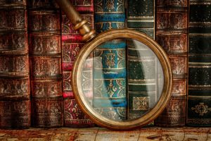 mystery writers old books and magnifying glass