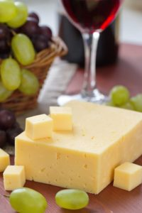 Cheese fresh grape and red wine in glass