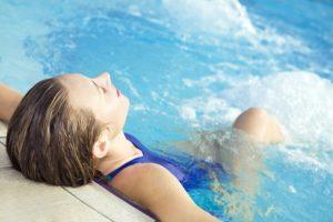 Women relaxing in a hot tub