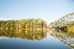 view of Connecticut River, with fall foliage and iron bridge from Whetstone Restaurant