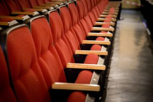 Oblique view over a row of red theatre seats at Latchis Theater