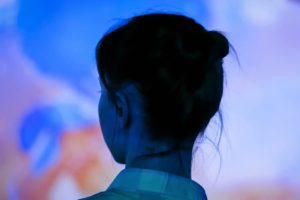 Back view of woman looking at an interactive exhibit at the Brattleboro Museum and Art Center